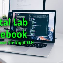 digital lab notebook is displayed with a pc in the background.